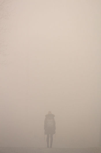 Person Standing In Fog