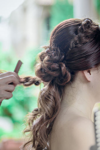 Cropped hand hair styling woman