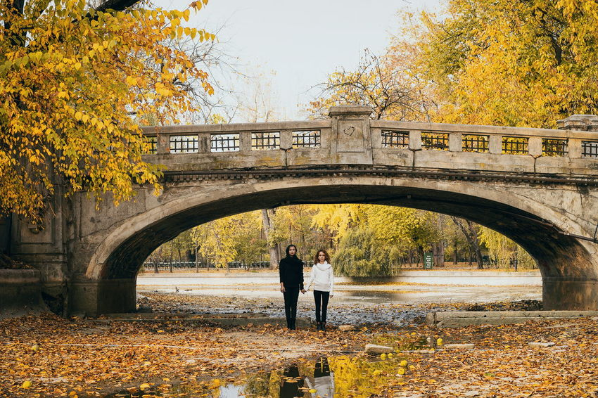Park Park - Man Made Space People Real People Women Looking At Camera Young Women Tree Full Length Autumn Silhouette Arch Architecture Sky Built Structure Arch Bridge Bridge - Man Made Structure Footbridge Archway Autumn Mood