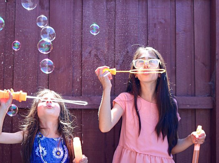 Two young girls with bubbles