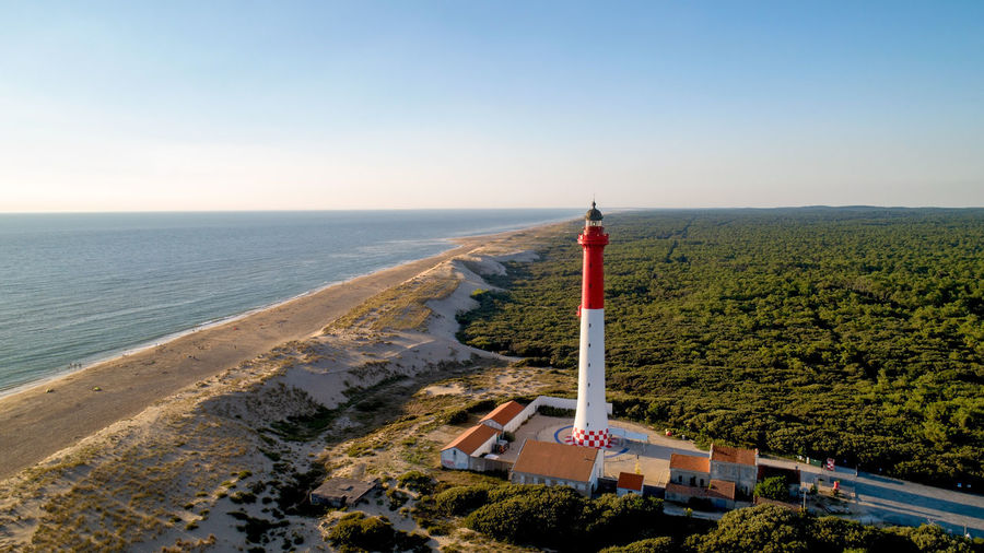 Aerial photography of lighthouse La Coubre in Charente Maritime, France Architecture Atlantic Ocean Charente-Maritime Coastline France Lighthouse Phare De La Coubre Red Aerial Photography Aerial View Beach Blue Coast Golden Hour La Tremblade Landscape Nature Navigation Navigational Equipment Outdoors Sea Sunset Tower Water White Color