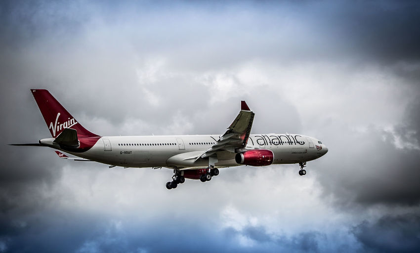 Virgin Atlantic Air Vehicle Airplane Airport Arts Culture And Entertainment Commercial Airplane Danger Depth Of Field Environmental Conservation Flying Guidance Journey Low Angle View Mid-air Mode Of Transport No People On The Move Outdoors Selective Focus Sky Transportation Vapor Trail