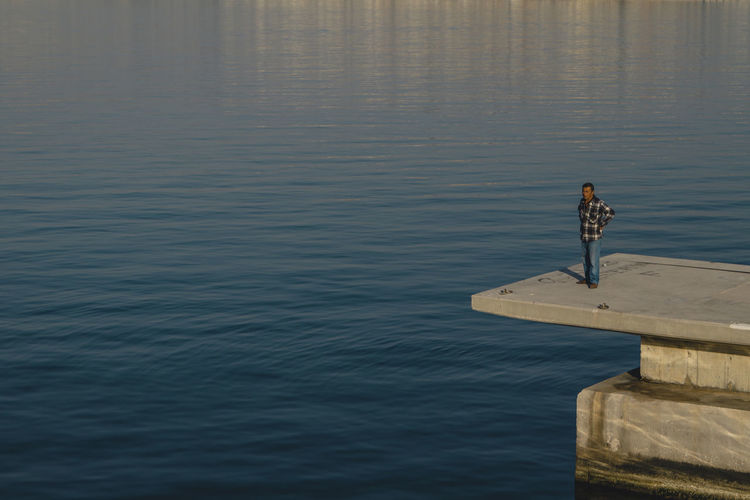 Beauty In Nature Day Full Length Leisure Activity Lifestyles Looking At View Men Nature One Person Outdoors Pier Real People Rippled Sea Standing Tranquility Water Waterfront