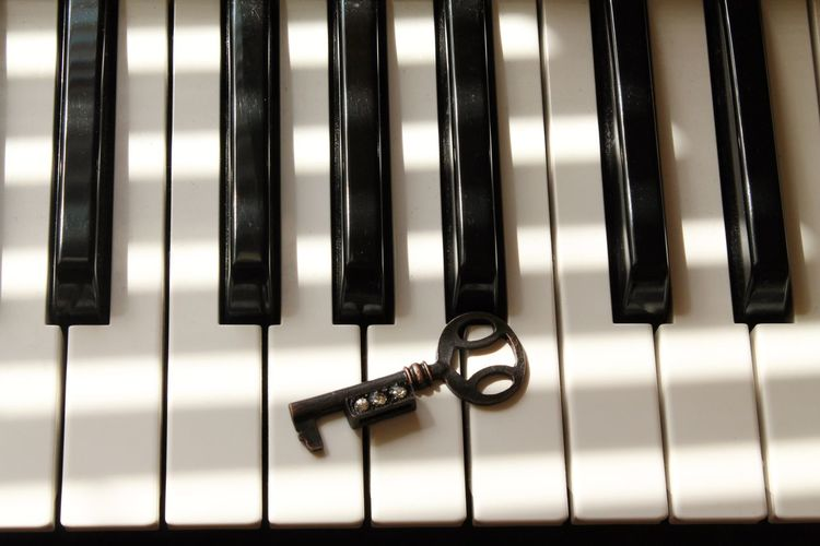 High Angle View Of Key On Piano At Home
