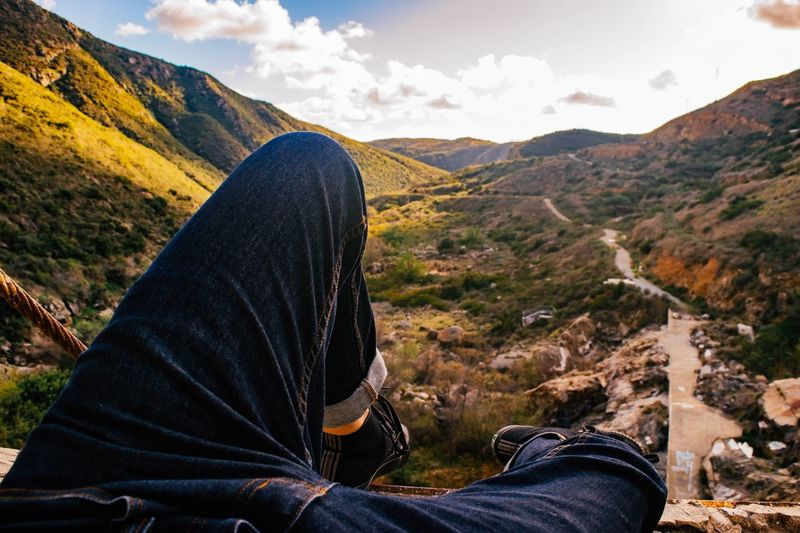 Love of life Love Landscape Life Beautiful Beauty In Nature One Person Mountain Leisure Activity Lifestyles Real People Sitting EyeEmNewHere Beauty In Nature Nature Personal Perspective Cloud - Sky Day Tranquility Human Leg Non-urban Scene Mountain Range