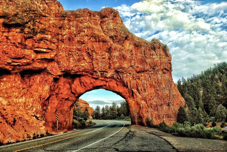 The Way Forward Road Day Arch Transportation Nature No People Sky Natural Arch Tranquility Beauty In Nature Cloud - Sky Outdoors Mountain Landscape Tree Canyon Tunnel The Week On EyeEm Perspectives On Nature