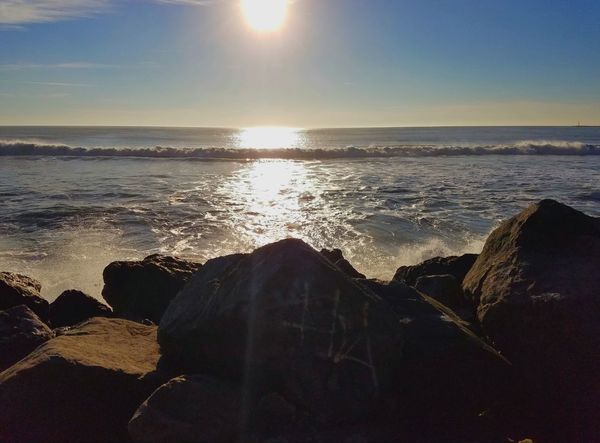 Sea Reflection Sunset Sunlight Nature Water Horizon Over Water Beauty In Nature Sky Tranquility Beach No People Outdoors Scenics Refraction Close-up Day Copy Space Shadow And Light Fine Art Photography Tranquility Rock Formation Pattern Texture Shape Design Power In Nature Coastal Feature