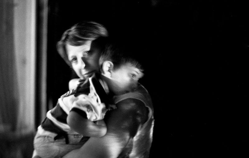 Love. Mommy Moment Of Silence Melancholy Kid Little Boy Mum And Son Darkness Window Sadness And Sorrow Outdoors Looking At Camera The Week On EyeEm EyeEmNewHere Film Noir Film Is Not Dead Filmisalive 35mm Film Photography Noir Et Blanc Portraits Analogue Photograhy BW_photography Woman Portrait Filmphotography Mother Filmsnotdead Black And White Friday Inner Power This Is Family Focus On The Story HUAWEI Photo Award: After Dark International Women's Day 2019