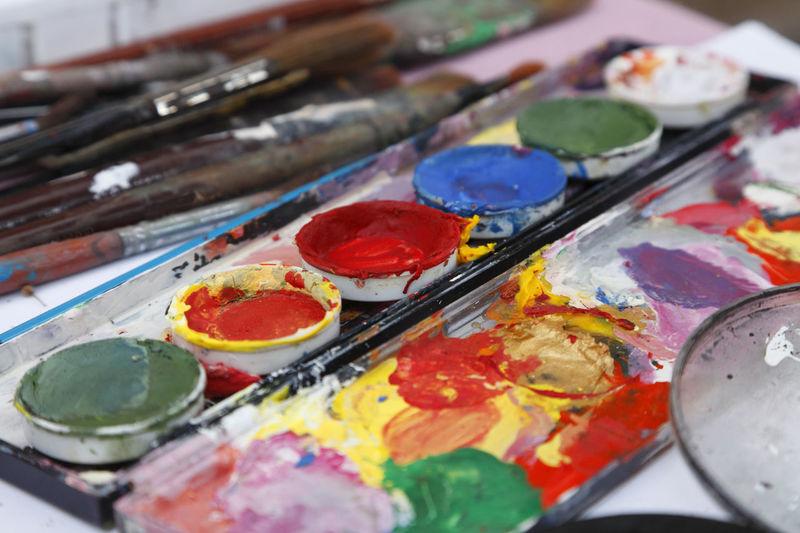 Painter's dyes palette-upper view. Aquarell Colors Aquarelle Art And Craft Art And Craft Equipment Art Studio Artist Arts Culture And Entertainment Close-up Colorful Craft Creativity Dyes Multi Colored Oil Paint Oil Painting Paint Paintbrush Palette Studio