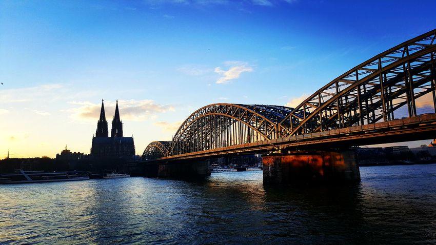 Köln Köln Cologne Bridge Blue Instagood Instadaily Instalike Instalove Instapicture Picture Pictureoftheday City Water Cityscape Bridge - Man Made Structure Sunset Blue Reflection Sky Architecture Built Structure Sculpture