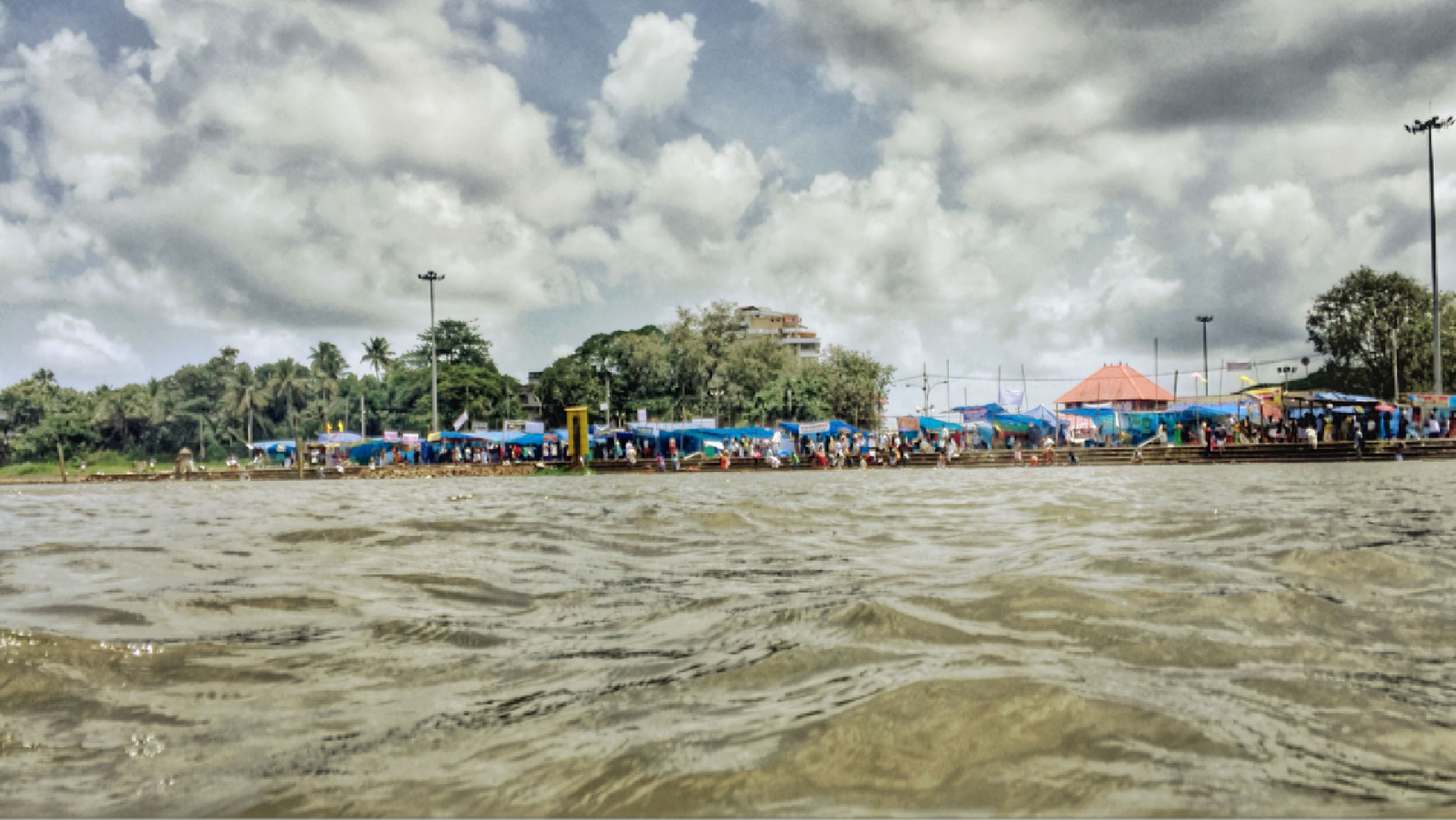 water, sky, cloud - sky, nautical vessel, sea, cloudy, boat, waterfront, transportation, mode of transport, cloud, beach, moored, nature, tranquil scene, tranquility, scenics, rippled, beauty in nature, day