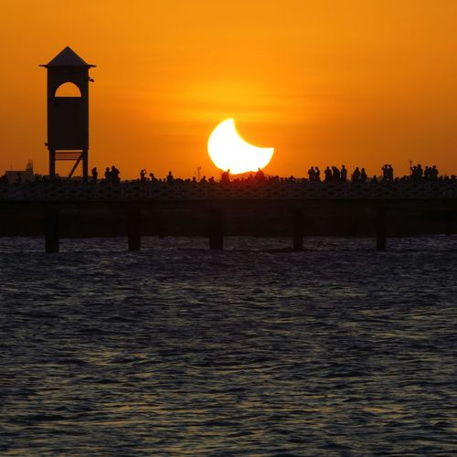 Eclipse Solar. Fortaleza, Ceará-Brasil Sunset Silhouette Nature Travel Destinations Beauty In Nature Tranquility Water Outdoors Vacations Landscape Tourism Scenics Sky Sea Beach Eclipse