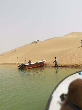 EyeEm Selects Sand Dune Men Water Clear Sky Nautical Vessel Sea Occupation Sand Fisherman Sky