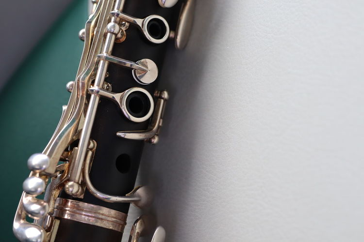 Close up clarinet Is a musical instrument such as wood blowers Musical Instrument Wind Instrument Gondola - Traditional Boat Music Hook Saxophonist Jazz Music Saxophone Flute Music Style  Soloist Fretboard Woodwind Instrument Blues Music