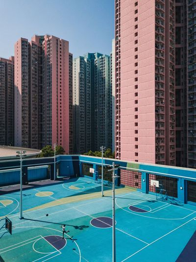 View of swimming pool against buildings in city