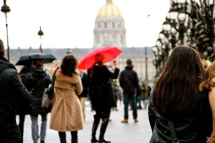 Rear View Of People At Les Invalides During Rainy Season
