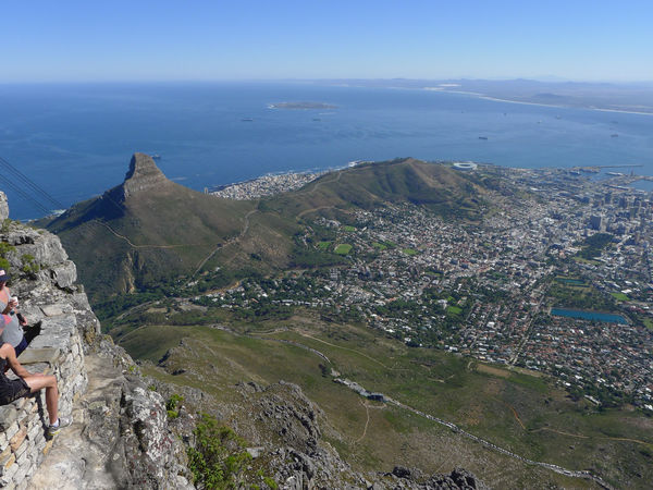 A view from table mountain over Cape Town with Lions Head, Signal Hill and Cape Town Stadium Architecture Beauty In Nature Cityscape Day High Angle View Landscape Lions Head Mountain Mountain Range Nature One Person Outdoors People Real People Scenics Signal Hill Sky Water