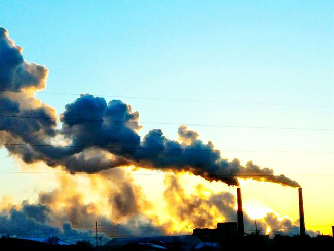 Steam rolling from the plant today. So cold, -40F windchill!! Buildings Cityscapes Cold Days Steam Sunset Ilovesunrisesandsunsets Sunset Silhouettes Smoke Smog Environmental Damage Emitting Atmospheric Cooling Tower Air Pollution Pollution Global Warming Heat