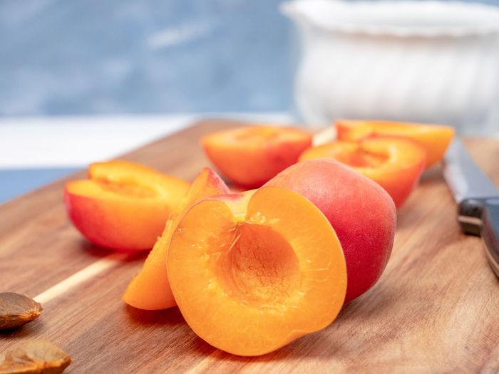 Close-up of orange fruits on cutting board