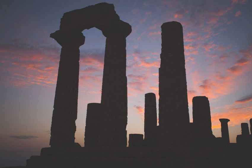 Sunset temples in Sicily, Italy. Sky Sunset No People Low Angle View Silhouette Outdoors Cloud - Sky Nature Day Temple Tranquil Scene Built Structure Ancient Italy Italy Sicily Creative Light And Shadow