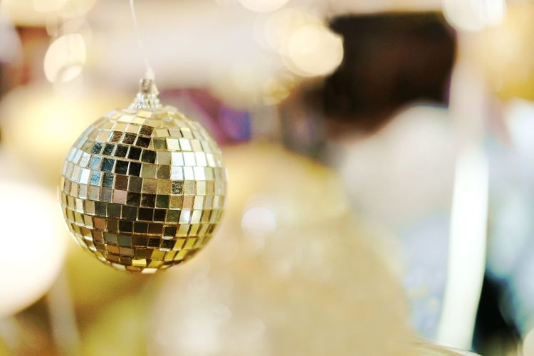 Beautiful lighting and Gold balls decorated hanging on White Christmas Trees Celebration with Bokeh blurred, fairy and sparkling background.Copy space Disco Ball Nightlife Sphere Nightclub Focus On Foreground Shiny Event Celebration Indoors  Reflection Party - Social Event No People Night Hanging Arts Culture And Entertainment Music Close-up Disco Dancing Mirror Dance Floor Silver Colored