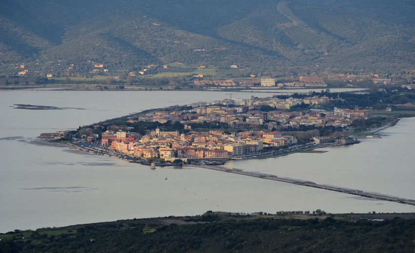 Aerial view of the Orbetello lagoon with the city located on the small peninsula in the middle of the lake, during sunset Orbetello Tuscany Lagoon Lake Aerial View Scenics - Nature Scenic View TOWNSCAPE Landscape Sunset EyeEm Best Edits EyeEmNewHere Water Architecture High Angle View City Building Exterior Cityscape Building Waterfront Residential District Outdoors No People Nature Built Structure Tourism Travel Destinations