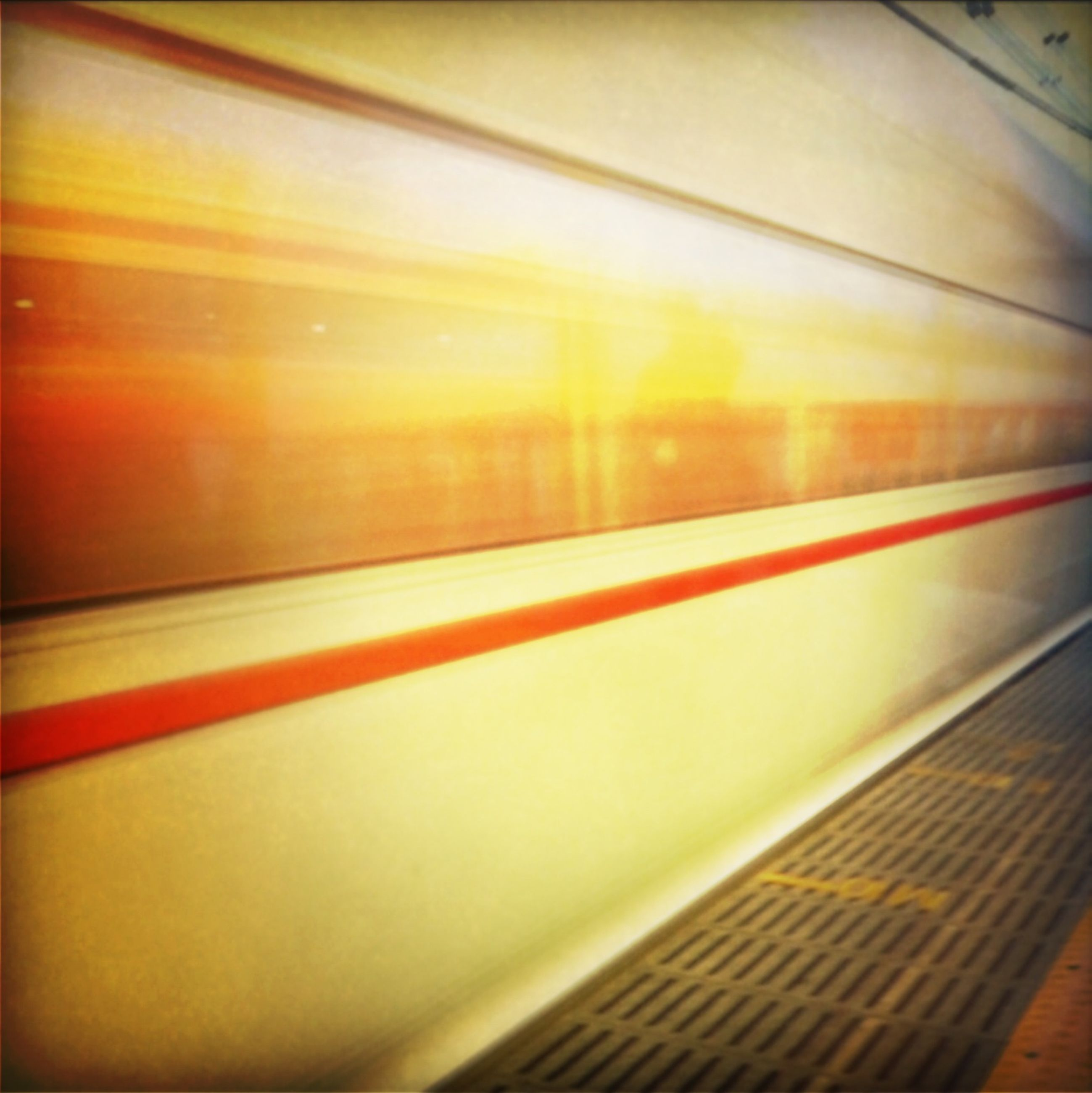 indoors, transportation, railroad station, public transportation, railroad station platform, illuminated, rail transportation, blurred motion, escalator, railing, subway station, motion, subway, speed, steps, railroad track, pattern, no people, high angle view, travel