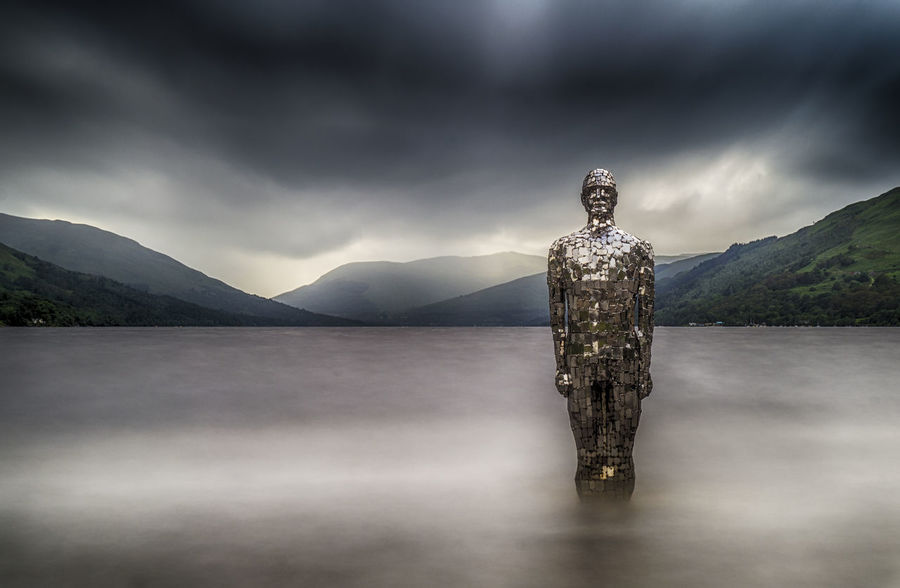 Here comes the Mirror Man It was pretty dull and windy today, and the waves were crashing around the feet of Still on Loch Earn. This 119 second exposure flattened out the water. Beauty In Nature Cloud - Sky Day Human Representation Lake Landscape Loch Earn Male Likeness Mountain Nature No People Outdoors Scenics Scotland Scottish Highlands Sculpture Sky Statue Tranquil Scene Tranquility Tree Water Weather