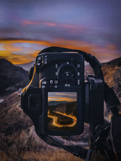 CURVE Sky Photography Themes Sunset Technology Camera - Photographic Equipment Cloud - Sky Nature Photographic Equipment Beauty In Nature Digital Camera Activity Camera Scenics - Nature No People Close-up Photographing Land Outdoors Orange Color Dramatic Sky