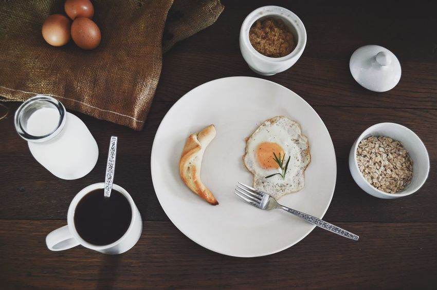 Rustic Farmhouse breakfast flatlay Breakfast Flatlay Burlap Close-up Crescent Roll Directly Above Egg Egg Flatlay Farm Eggs Flat Lay Food Food And Drink Food Flat Lays Freshness Healthy Breakfast Healthy Eating High Angle View Indoors  No People Old Fashioned Plate Ready-to-eat Rustic Breakfast Rustic Food Sunny Side Up Table