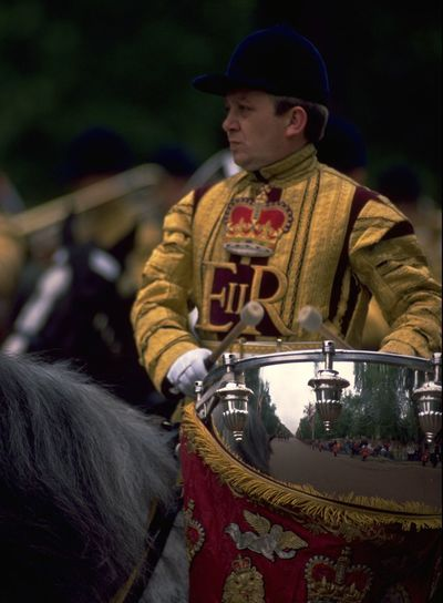 Drum horses are a traditional part of the annual Trooping the Colour ceremony on Horse Guards Parade; to celebrate Queen Elizabeth II's official birthday, on the second Saturday in June. After the ceremony, those without tickets can catch a glimpse of the Household cavalry and Band of the Life Guards as they accompany The Queen and the rest of the Royal Family back down The Mall to Buckingham Palace. http://pics.travelnotes.org/ Blurred Background British Ceremonial Snap A StrangerEngland Focus Focus On Foreground Life Guards London London Lifestyle Men Michel Guntern Official Birthday Period Costume Queen Elizabeth  Reflections Selective Focus The Mall Travel Travel Destinations Travel Photography Travel Photos Travel Pics Trooping The Colour Uniform