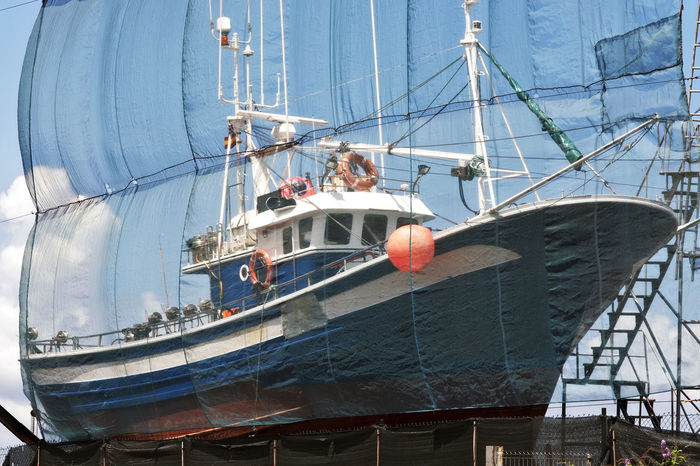 sailboat in shipyard for repair and maintenance in marina port Fishing Fishing Boat Fishing Boats Galicia Galicia, Spain Industry Maintenance Marine Marine Industry Nautical Nautical Vessel No People Outdoors Portrait Ship Ships Shipyard Shipyards Transportation Vessel Vessel In Port