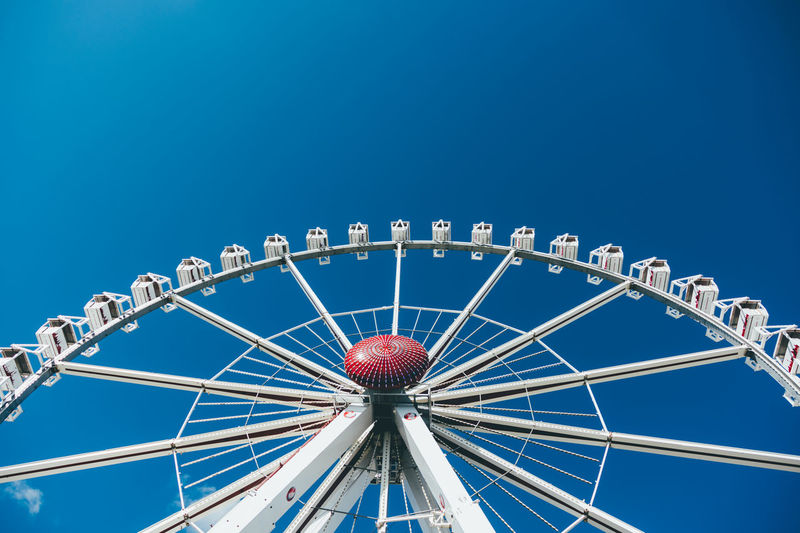 Ferris wheel at a fun fair in Hamburg, Germany Fun Funfair Hamburg Perspective Amusement Park Amusement Park Ride Arts Culture And Entertainment Big Wheel Blue Blue Sky Carousel Circle Clear Sky Day Fair Ferris Wheel Leisure Activity Low Angle View Merry-go-round No People Outdoors Sky Skyporn Street Photography Streetphotography