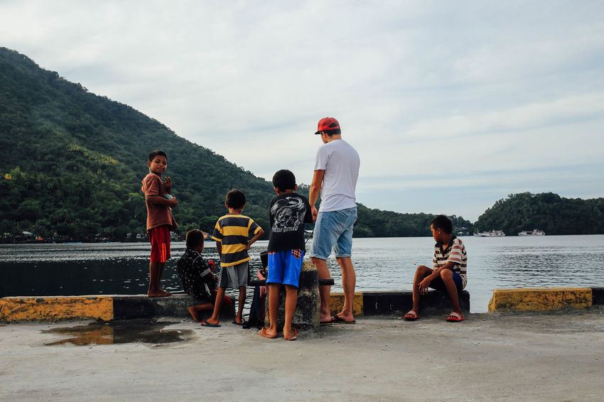 Angler ASIA Banda Island Casual Clothing Children Cloud - Sky Fisherman Fishing INDONESIA Kid Kids Leisure Activity Men Mountain Nature Sea Sitting Sky Standing Togetherness Water Connected By Travel