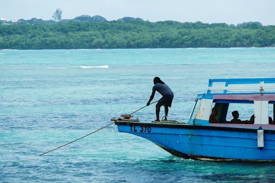 Tobago life Fishing Water Fishing Net Fisherman Sea Nautical Vessel Beach Outdoors Nature One Person People Occupation Adult Day Adults Only Real People EyeEm Best Shots Eye4photography  Open Edit Fresh 3 Nature One Man Only Sea Life