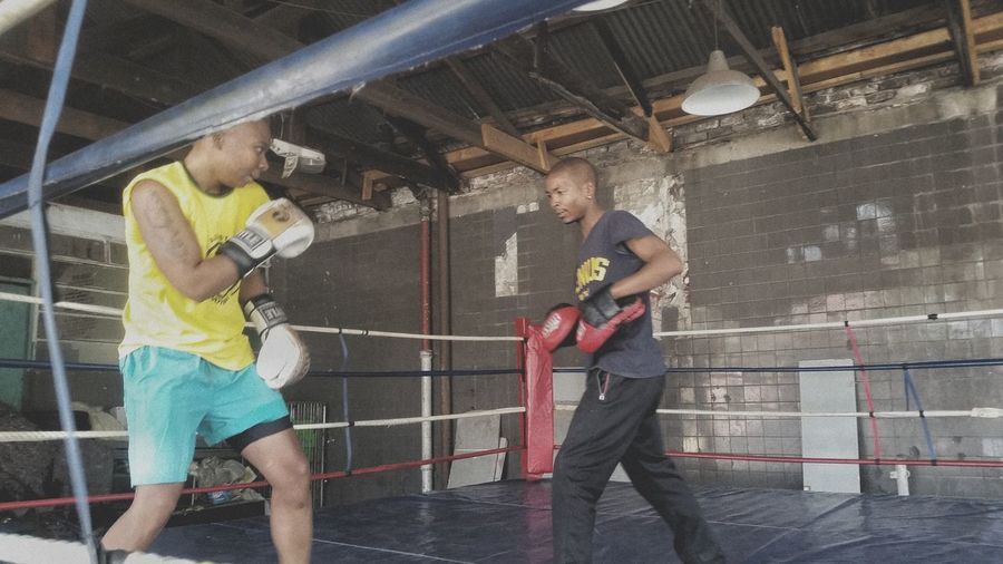 Sports Clothing Healthy Lifestyle Lifestyles Togetherness Exercising Females The Week On EyeEm Coach Boxing Ring Boxing Gym Athlete Architecture Two People South Africa 🇿🇦 Young Women Teamwork Friendship Yellow Flower Yellow Color Indoors  Boxing Activity Sport EyeEm Ready