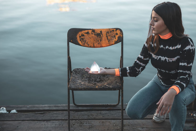 Real People One Person Young Adult Water Lifestyles Sitting Leisure Activity Casual Clothing Burning Nature Young Women Fire Flame Women Looking Sea Day Outdoors Beautiful Woman 17.62° My Best Photo