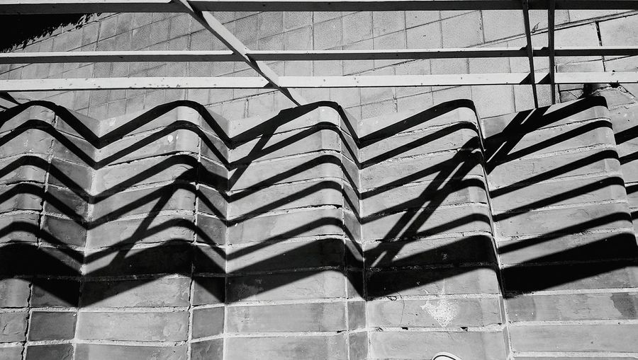 I mostly look up, when it comes to Urban Geometry But I find Looking Down can be an interesting change. Light And Shadow Interesting Mobilephotography Bnw_friday_eyeemchallenge Minimalism Blackandwhite Everybodystreet Notes From The Underground