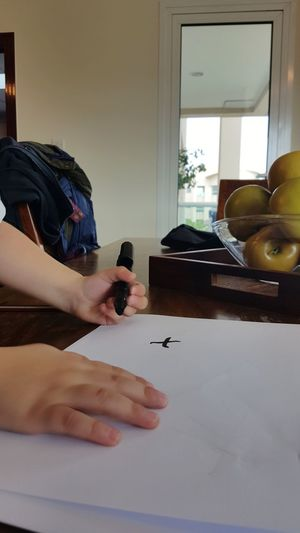 Low section of child on table at home