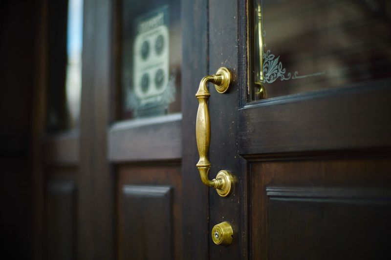 Gold handle on wooden door
