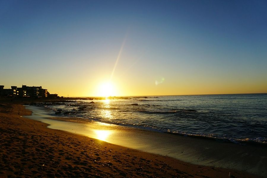 Sea Sunset Beach Sun Horizon Over Water Water Sand Travel Destinations Vacations Lens Flare Sky Scenics Sunlight Reflection Tourism Outdoors Summer Nature Tranquil Scene Tranquility