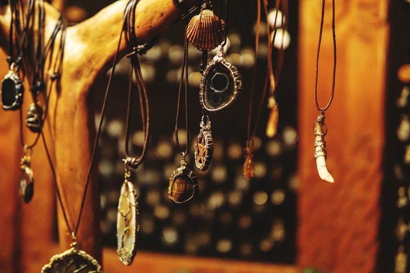 Close-up of necklaces hanging at market stall