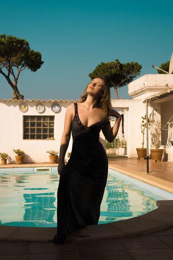 Woman looking at swimming pool