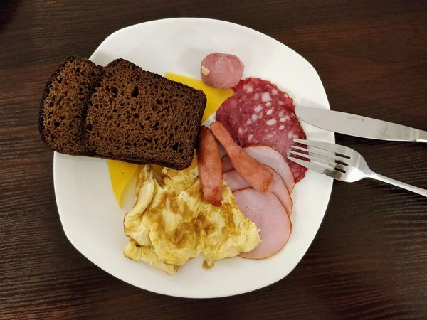 Breakfast Food And Drink Sausage Egg Meat Plate Food Fork Table Bacon Ready-to-eat Indoors  Fried Egg Bread Serving Size No People Healthy Eating Close-up Freshness Directly Above Kiev Ukraine Brunch