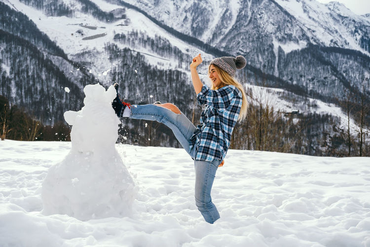 Woman standing on snow covered landscape