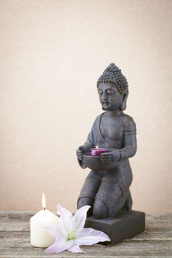 Statue of Buddha with candle Candle Toning Up Massages Buddhastatue Zen Yoga Mind  Dirty Soul Buddhaful Buddha Head Buddha Image Buddha Statue Photography Buddha Buddhism Massage Therapy Aromatherapy Relaxing Buddha Statues Buddhist Buddha Face Fire Lily Flower