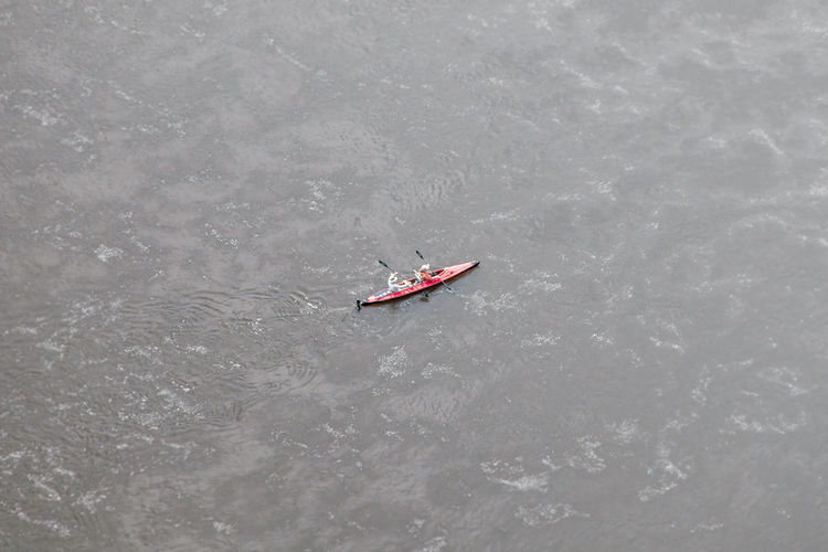 High angle view of people on boat in sea
