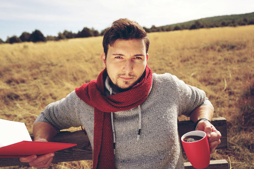 One Person Front View Looking At Camera Real People Young Adult Portrait Young Men Land Field Leisure Activity Cup Lifestyles Food And Drink Casual Clothing Waist Up Nature Coffee Coffee Cup Drinking Outdoors Scarf Warm Clothing