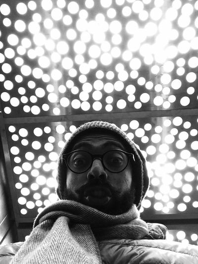 Low angle view of man wearing eyeglasses at home