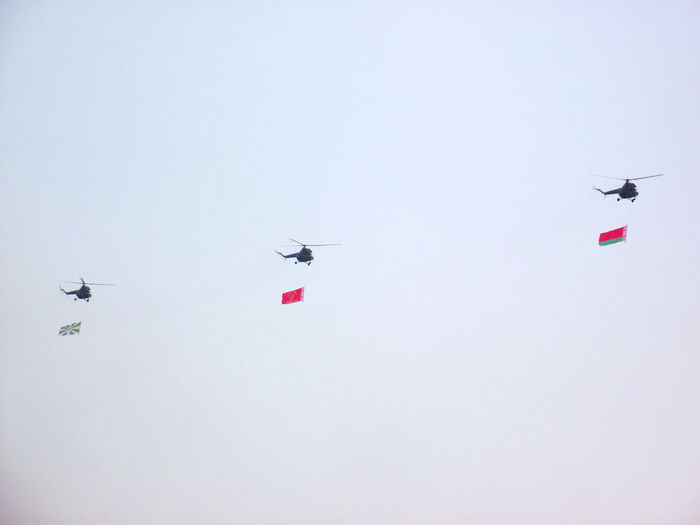 Air Vehicle Army Celebration Clear Sky Day Flags Flying Helicopter Independence Day Low Angle View No People Outdoors
